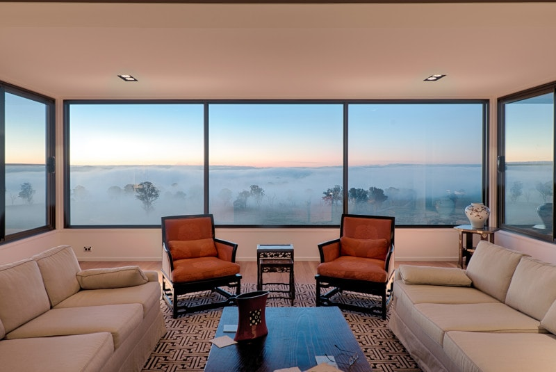 mist country views from cantilevered hill top house