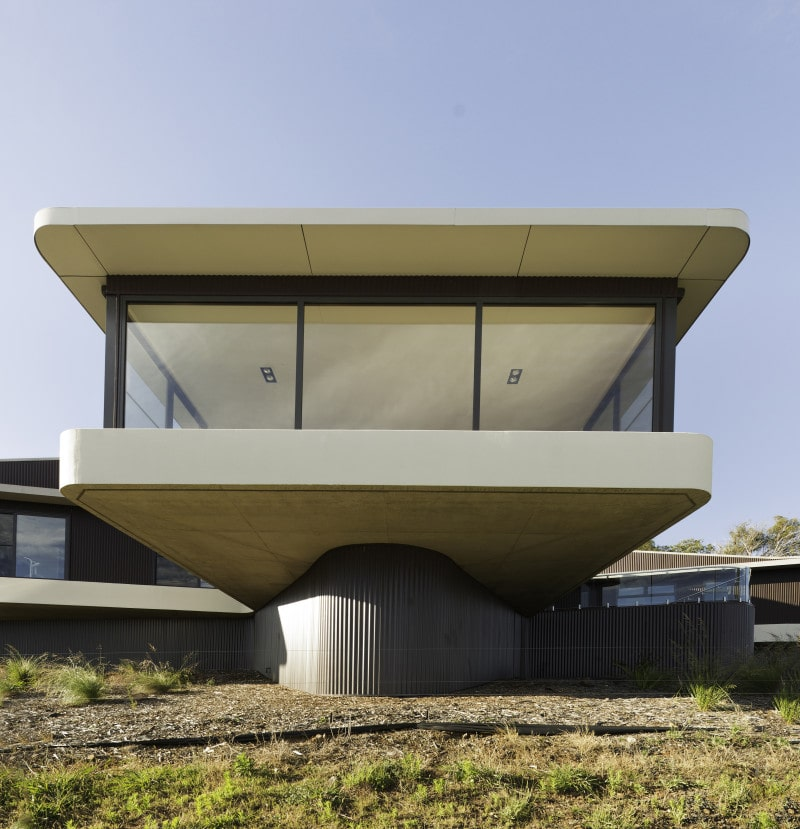 cantilevered concrete slab living room curved retaining walls