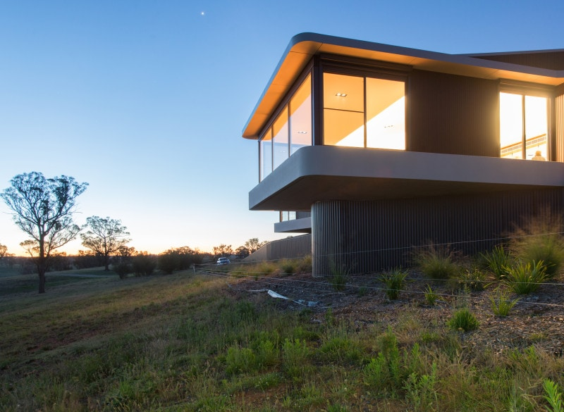 cantilevered hill top house dusk country architecture