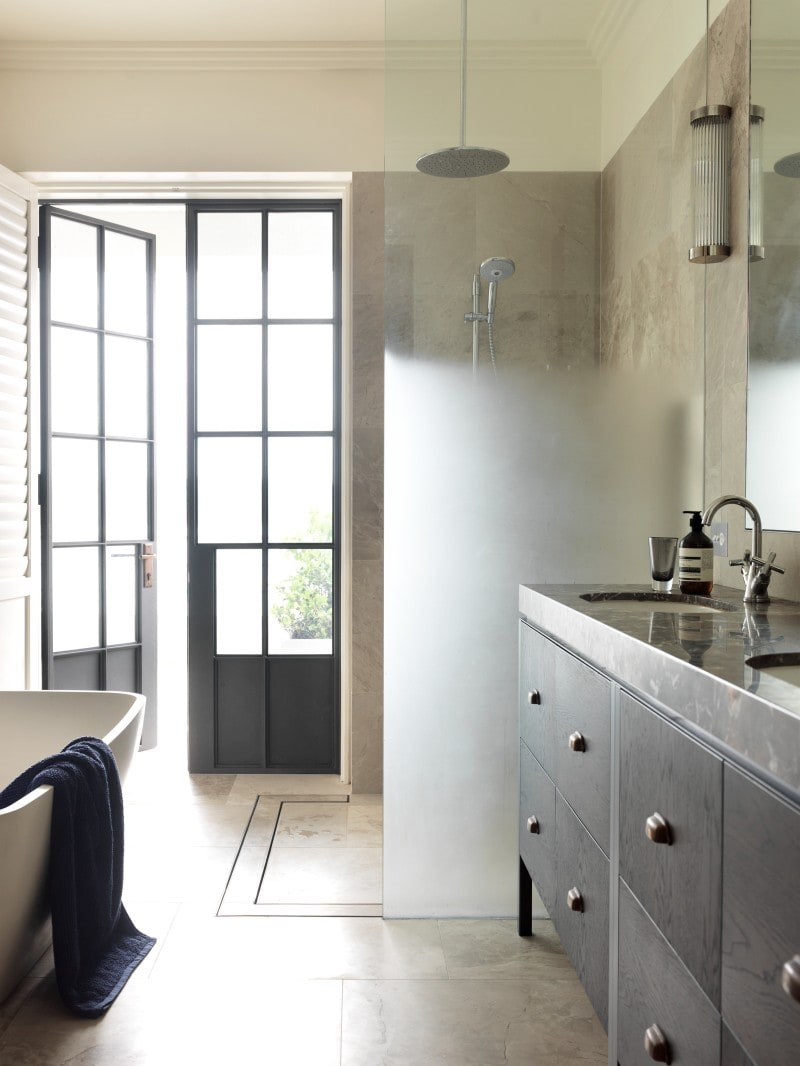 lime stone tiled bathroom marble vanity fine black steel French doors