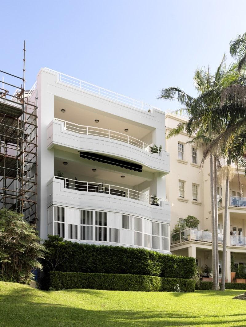 white shutter enclosed balcony