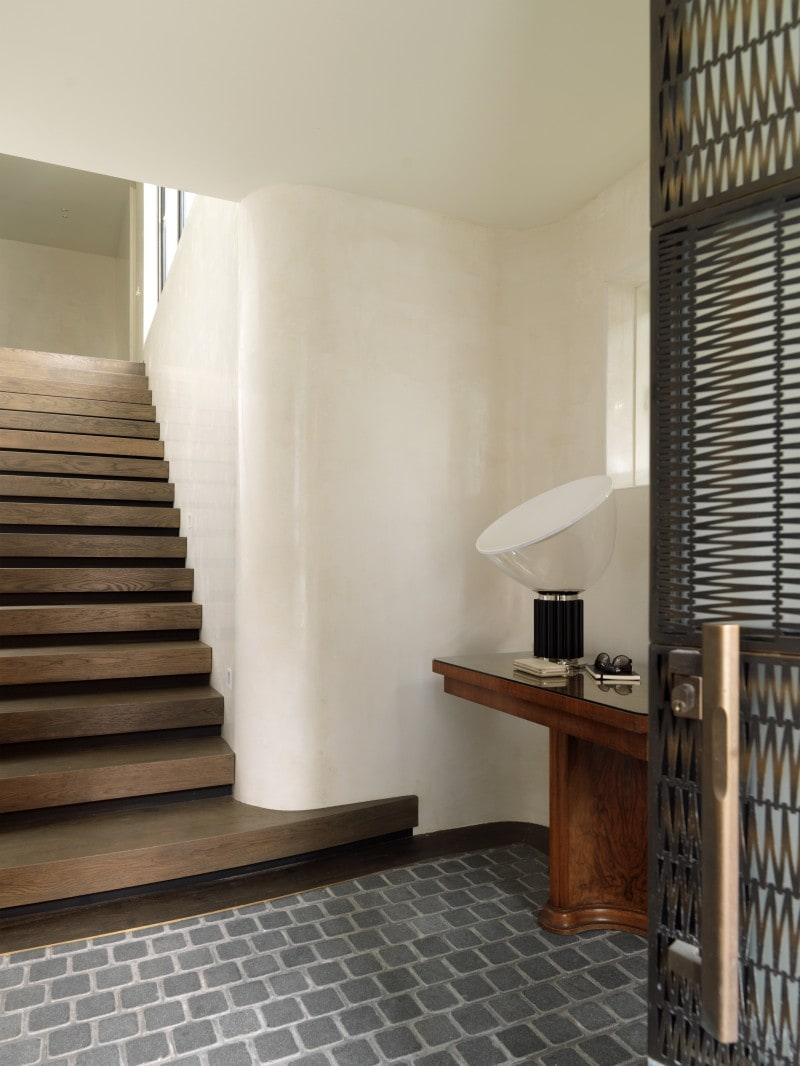 Tiled Entry Floor, Dark Walnut Timber Stair Case, Curved Walls, Decorative brass filigree door timber stairs