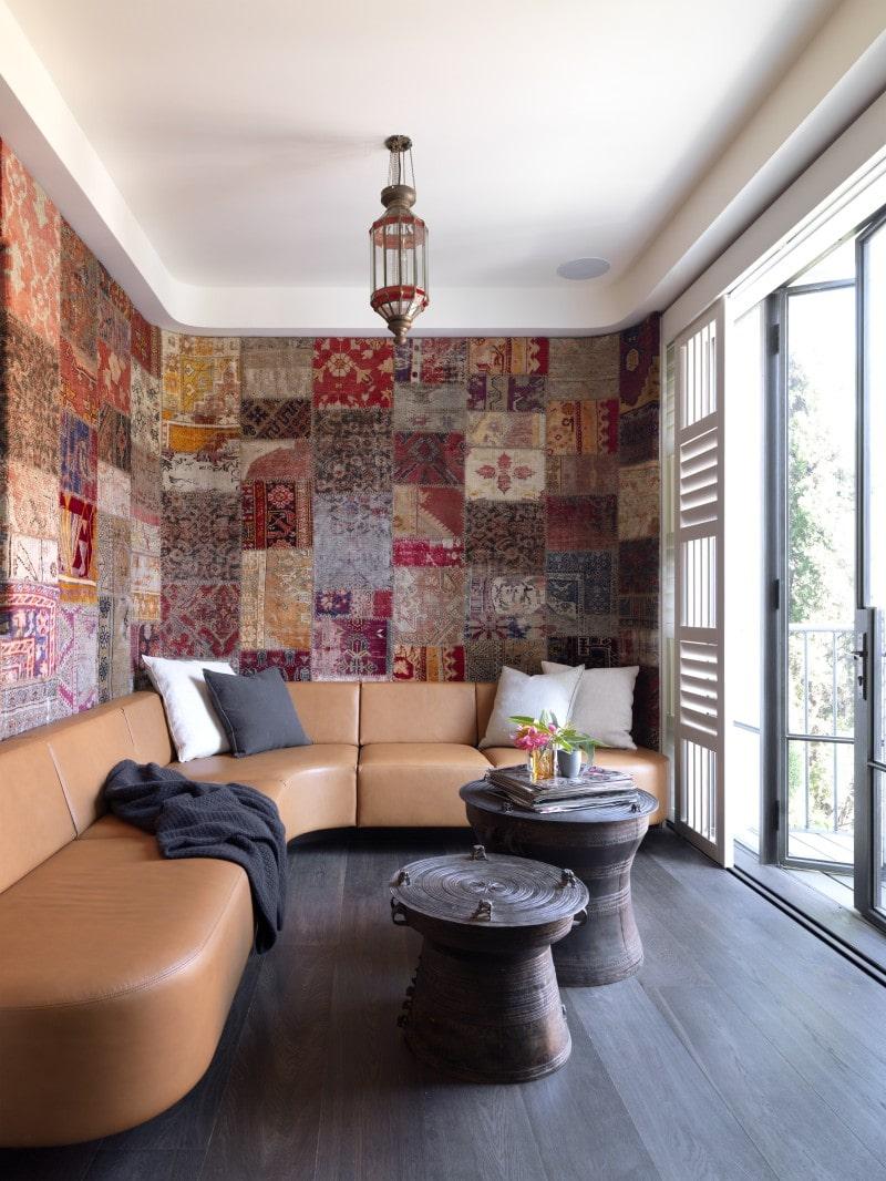tapestry lined sun room dark timber floors