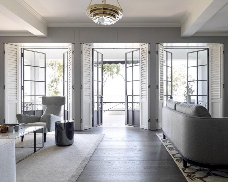 Luigi Rosselli, Light filled living room with thin black steel framed French doors