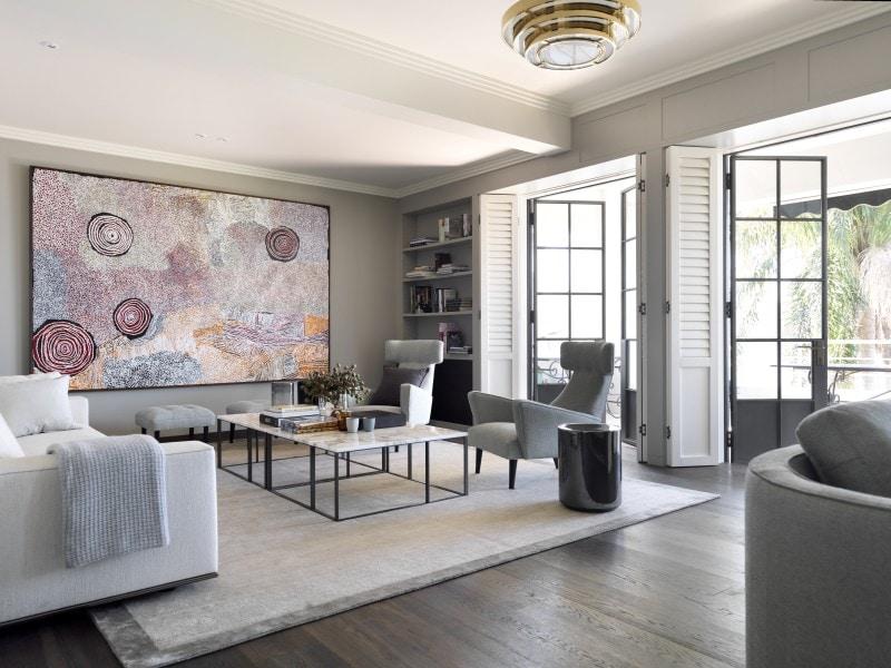 Luigi Rosselli, Light filled living room with thin black steel framed French doors and dark timber floors