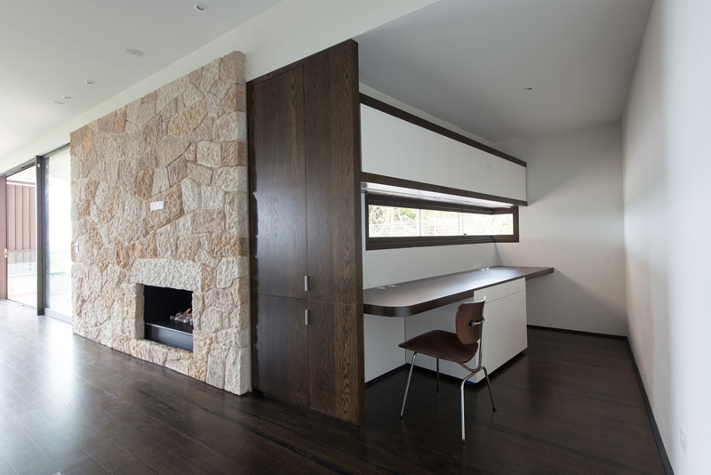 sandstone living room feature wall recessed fireplace