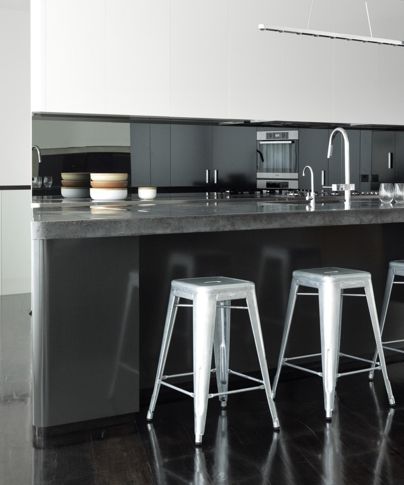 solid polished concrete benchtop with black oxides