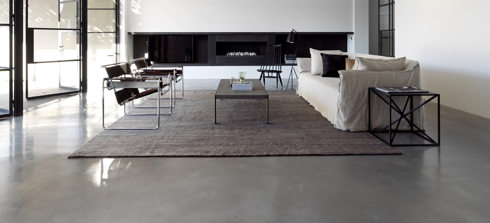 Luigi Rosselli Architects | polished concrete floor in a