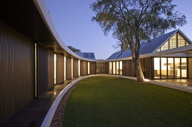 Most of the lights are LED and the courtyard could function with borrowed light from the house.  The kitchen on the right has its own terrace at the same floor level. © Edward Birch