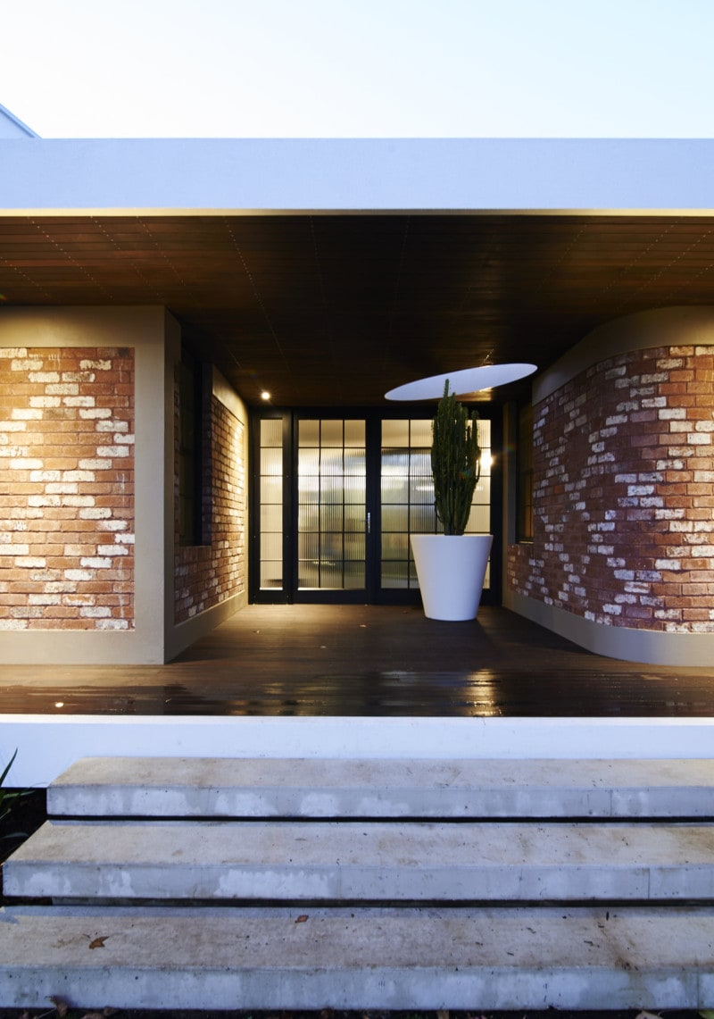 Luigi Rosselli, Recycled Brick Wall, Thin Steel Attic Windows, Patterned Brick, curved recycled brick wall ribbed glass steel doors entry