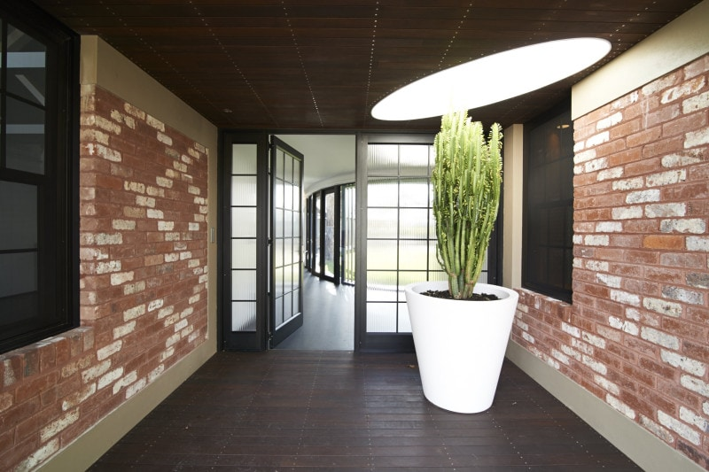 Luigi Rosselli, Recycled Brick Wall, Thin Steel Attic Windows, Patterned Brick, elliptical skylight timber board ceiling