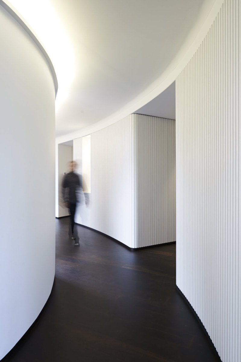 Luigi Rosselli, curved white ribbed timber panel wall