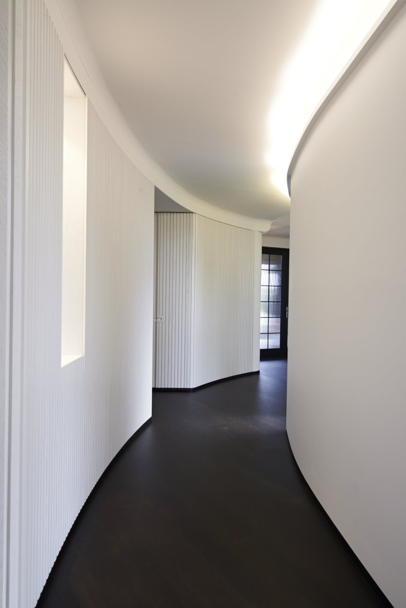 curved white ribbed timber panel wall