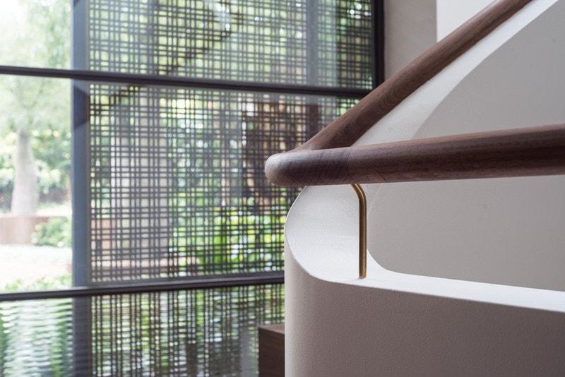 timber handrail and masonry balustrade
