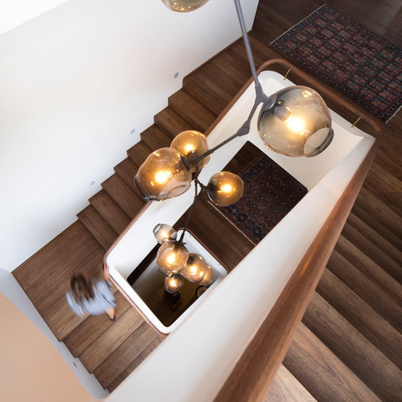 winding staircase with Lindsey Adelman chandelier