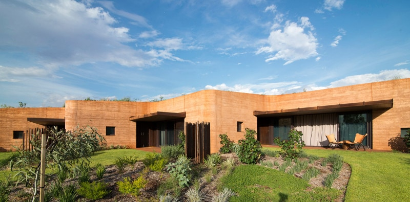 Luigi Rosselli, Building in Landscape, Building Integrated in Landscape, Rammed earth facade carved out of the hill