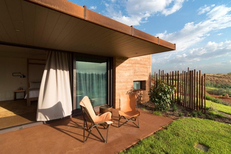 Cor-Ten steel awning, Rammed Earth Walls, Rammed Earth Dwelling, Outdoor Sitting Area