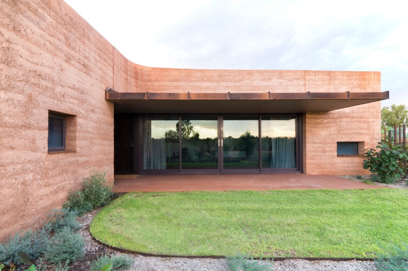 Cor-Ten steel cyclonic shade frame, Luigi Rosselli, Rammed Earth, Rammed Earth Building, Rammed Earth Dwelling, Lawn, Awning