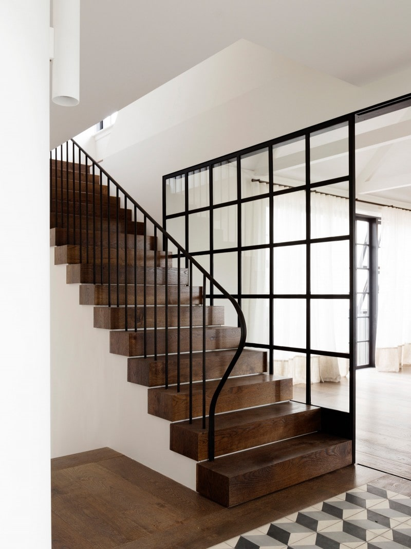 encaustic Escher pattern Luigi Rosselli, Classic Black Steel Curved Balustrade, Dark Timber Stair, Glazed Sliding Internal Door Steel, Contrast Timber