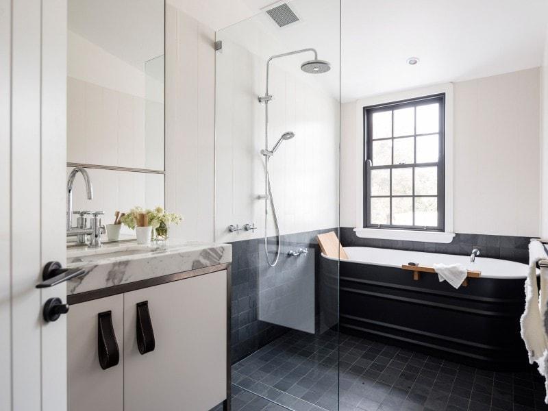 steel bath and marble vanity