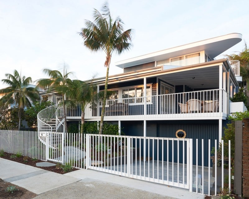 white picket fence and weatherboard beach house