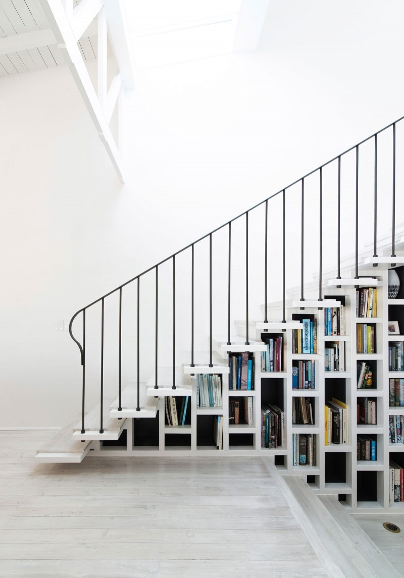 light filled staircase with library