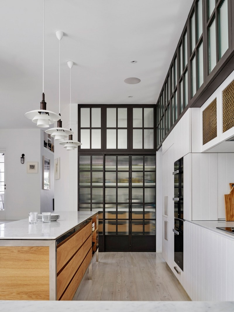 Luigi Rosselli, Carrara marble bench, Louis Poulsen lights, steel windows, Timber Cabinetry, Brass Mesh Cupboards, Kitchen