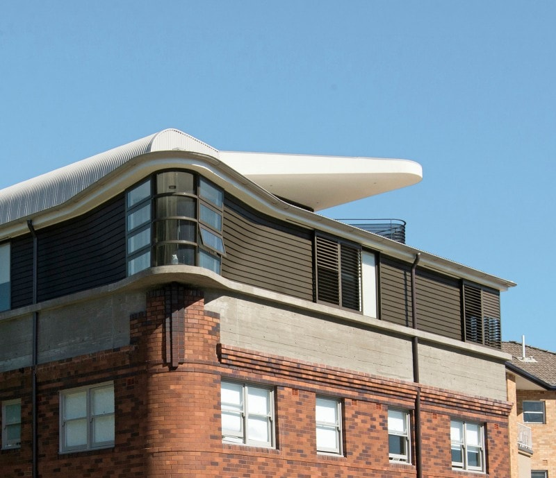 Luigi Rosselli, Brick, Curved Windows, Curved Roof, Brick Facade, curved metal roofing on Captain's deck balcony