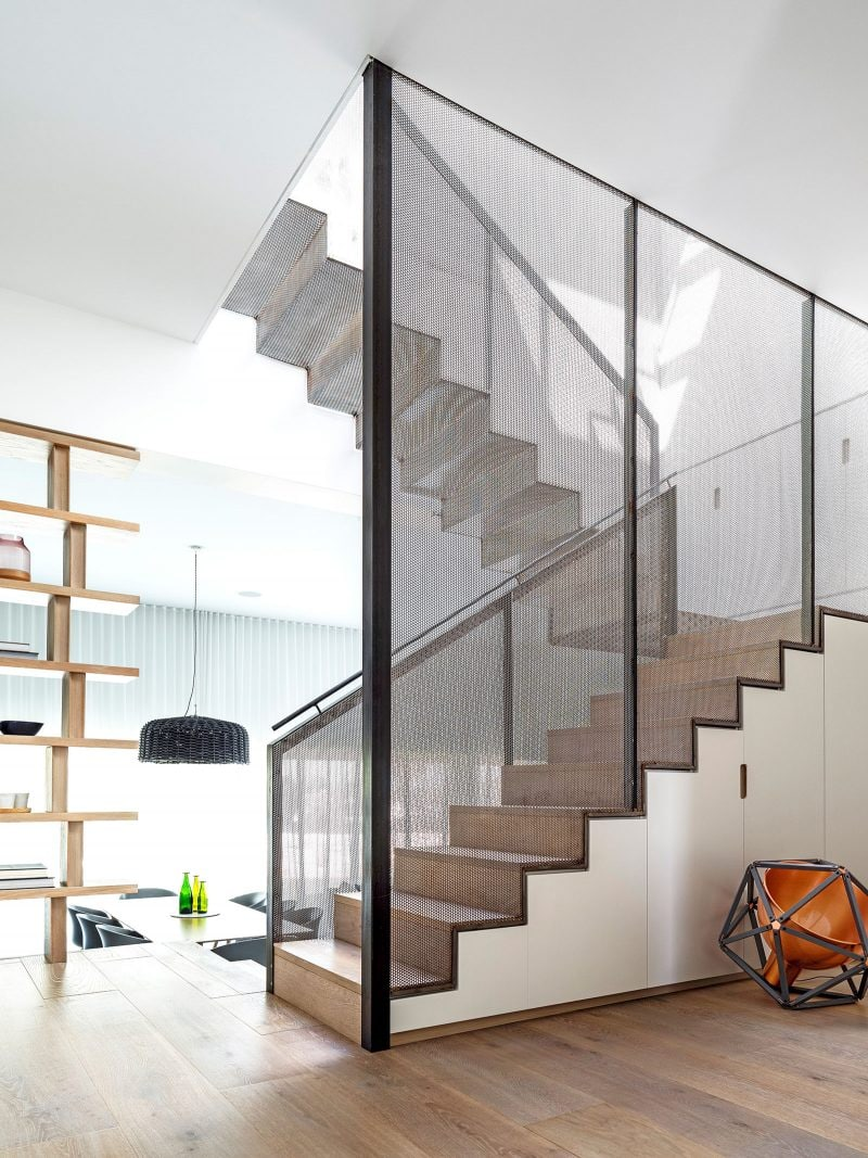 semi-transparent perforated black steel staircase