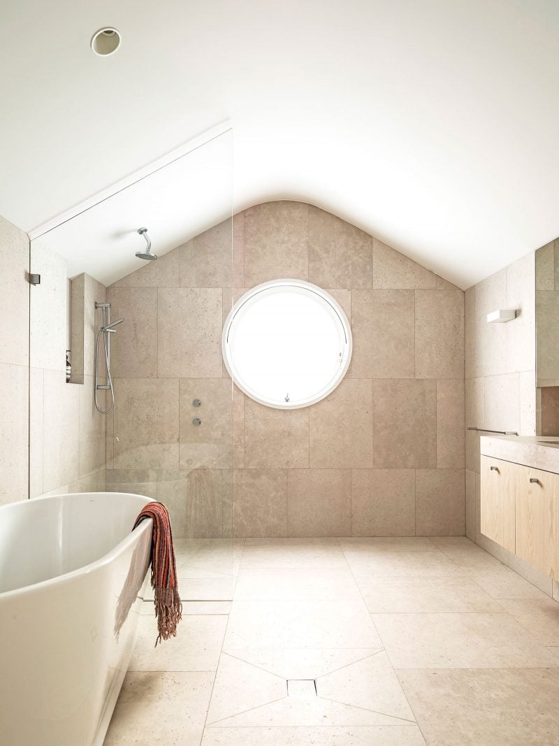 round window limestone bathroom floor