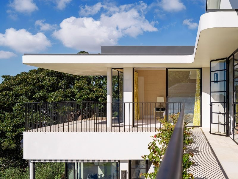 modern style curved balcony with thin framed steel windows