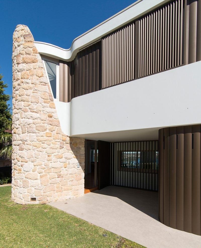 Curved sandstone wall anodised aluminium adjustable louvers