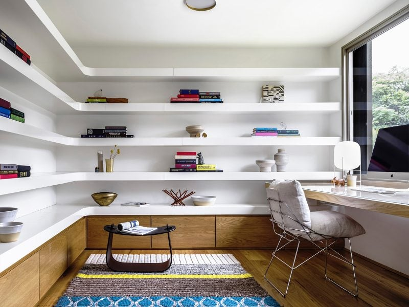 curved white bookshelves home office