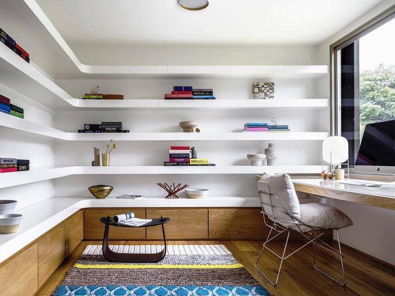 curved white bookshelves home office