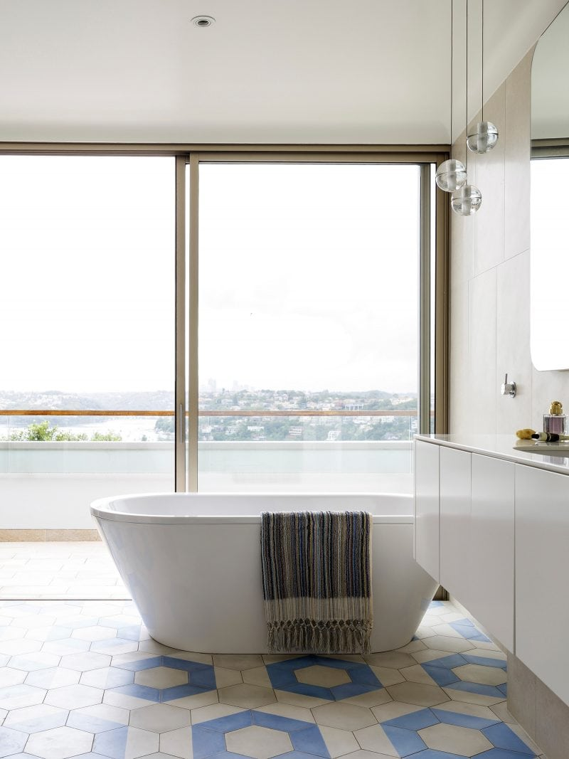 Freestanding bath with Sydney harbour views geometric tiled floor