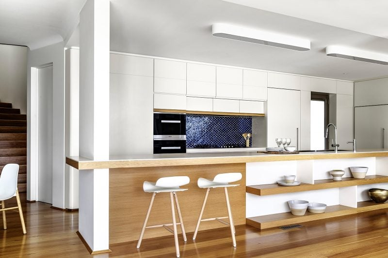 Clean white kitchen with timber kitchen island