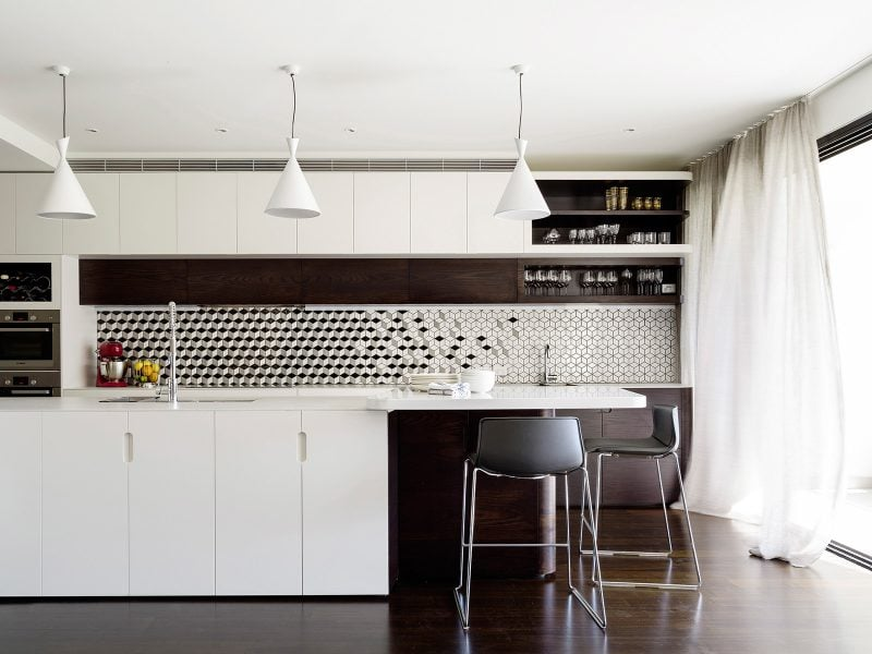 white kitchen island geometric tile splashback