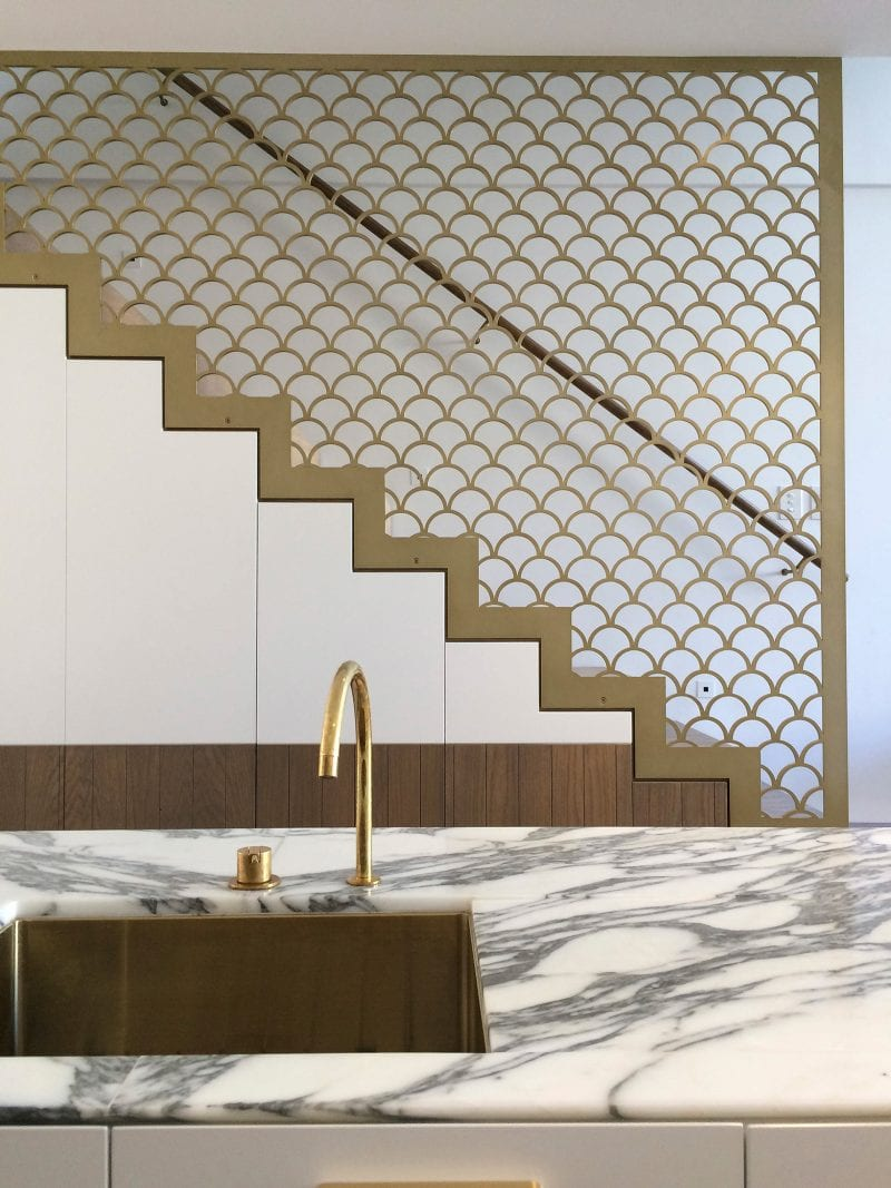Luigi Rosselli Architects | Brass finish fish scale balustrade stair and marble benchtop