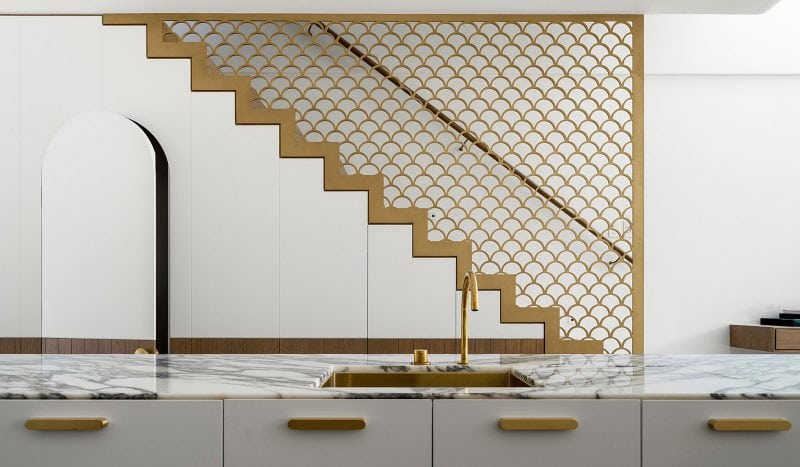 Luigi Rosselli Architects | Terrace house with brass finish fish scale balustrade stair, carrara marble benchtop and arched door