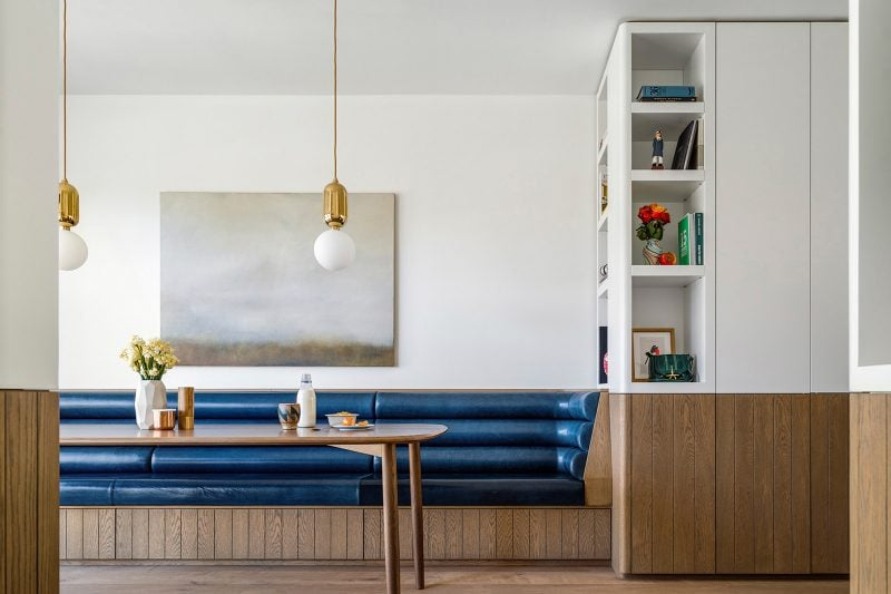 Luigi Rosselli Architects | Dining room with Eileen Gray inspired padded bench seat in blue leather, timber joinery and brass accents