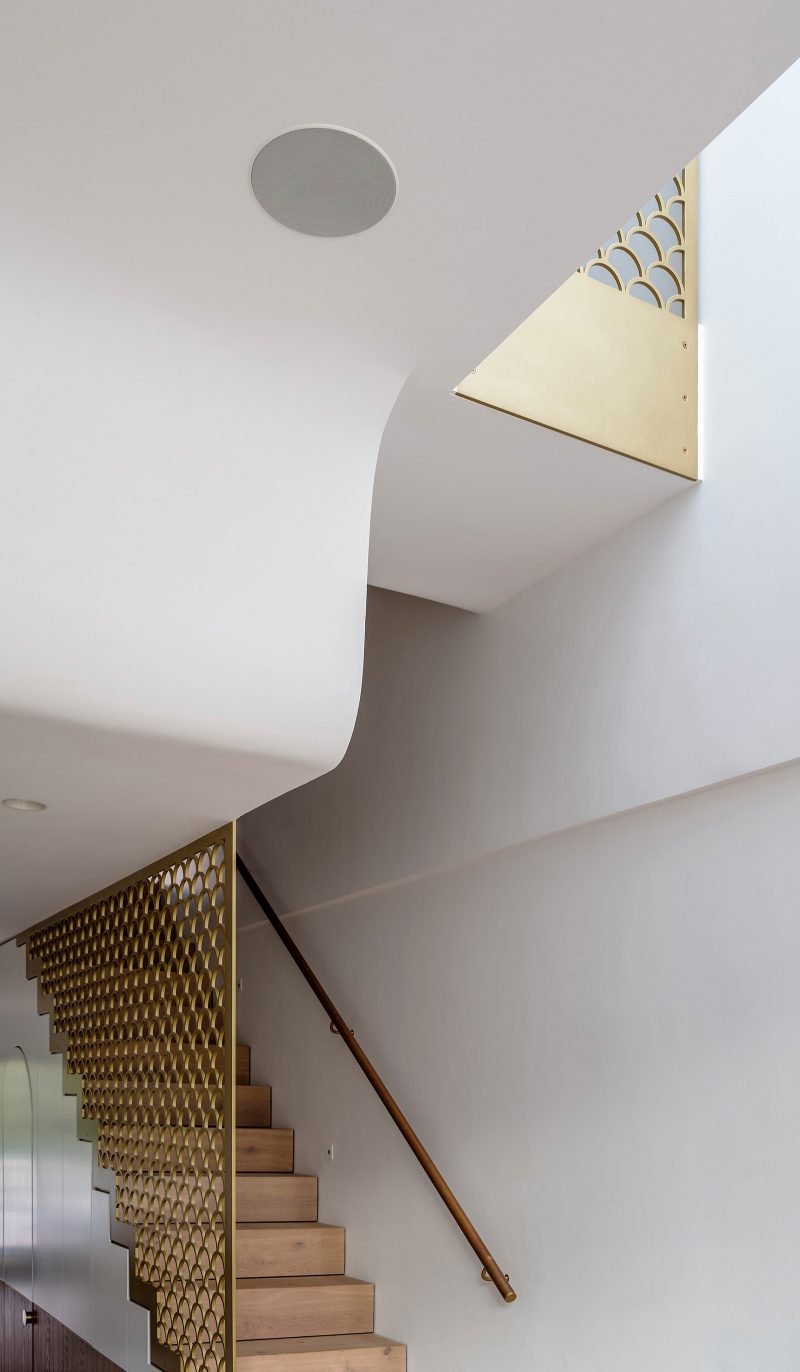 Luigi Rosselli Architects | Sculpted curved ceiling brass fishscale balustrade timber stair