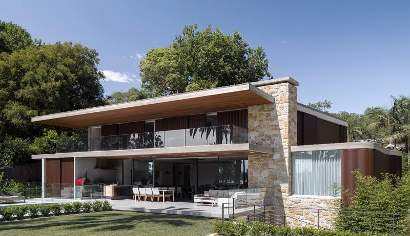 Sticks and Stones Home - Wide eastern elevation of sandstone and timber with deep terrace and balconies