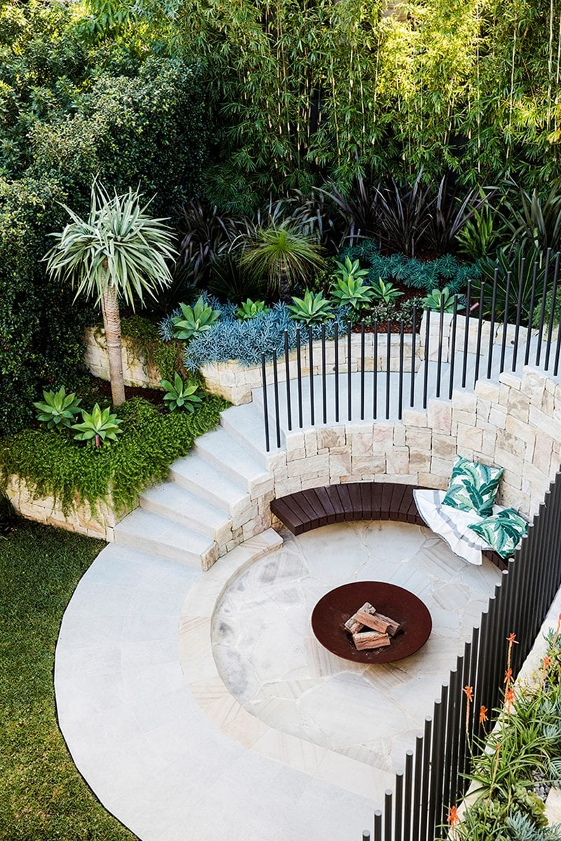 Luigi Rosselli Architects   Outdoor living with fire pit, sandstone curved stair, picket fence and landscaping