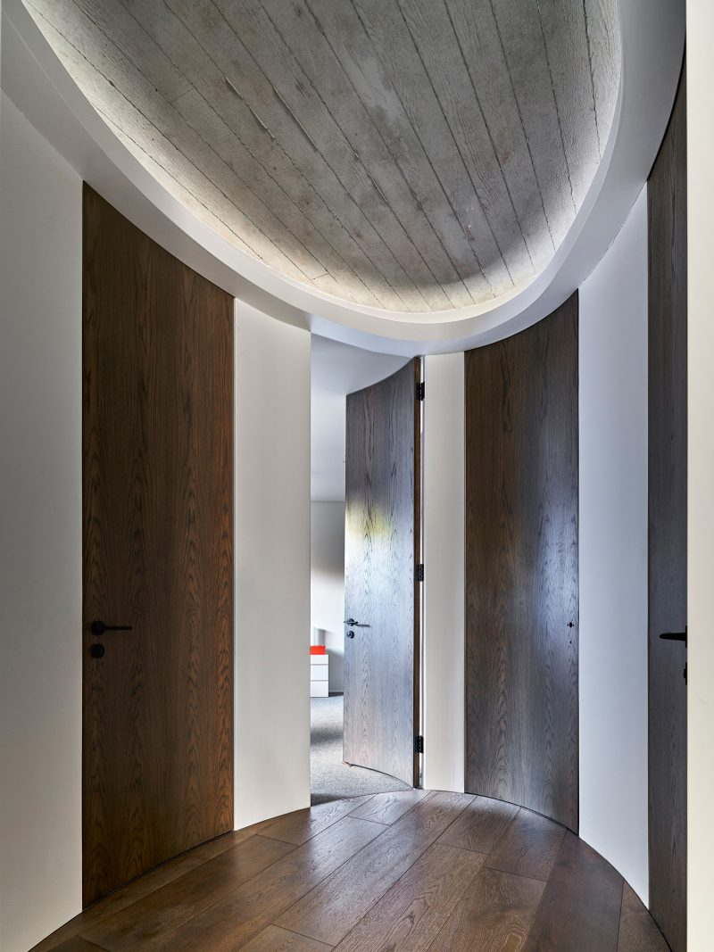 Luigi Rosselli, exposed concrete, smooth set plaster, oak timber, oval hall, curved doors