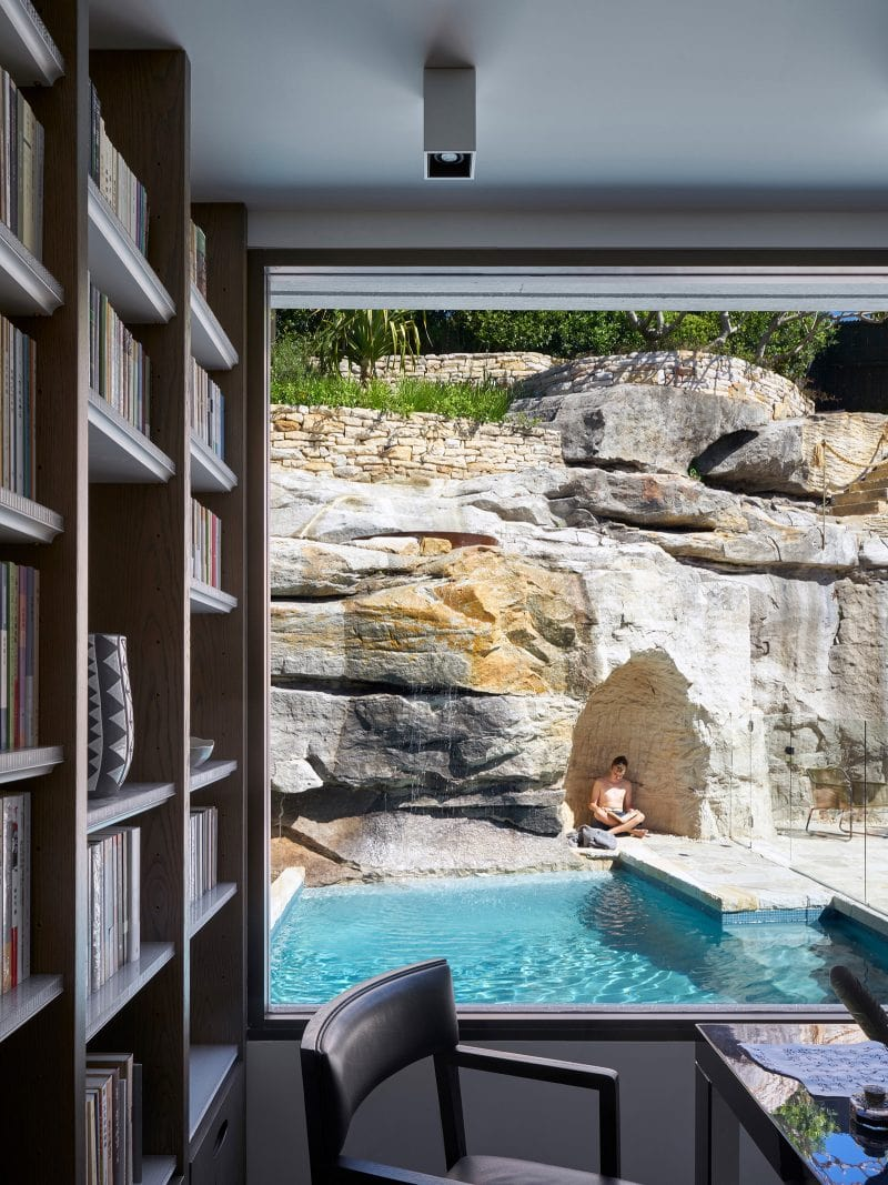luigi rosselli architects the books house study bookshelf with views over the pool and sandstone cliff