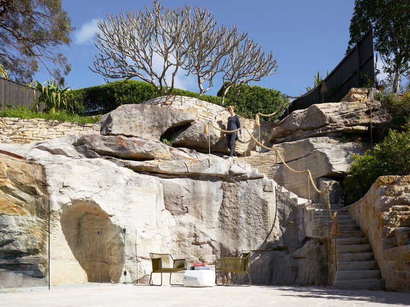 luigi rosselli architects the books house, sandstone cliff and stair with hemp rope leading to Frangipani tree and garden