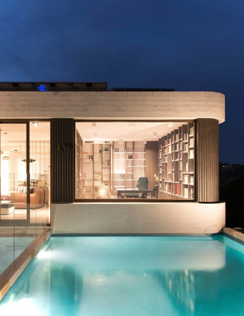 luigi rosselli architects the books house | Study with Oak joinery levitating over pool