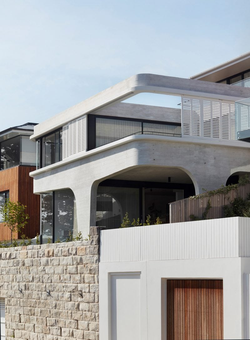Exterior of Luigi Rosselli designed tamas tee house in tamarama with sandstone, off-form concrete, timber shutters