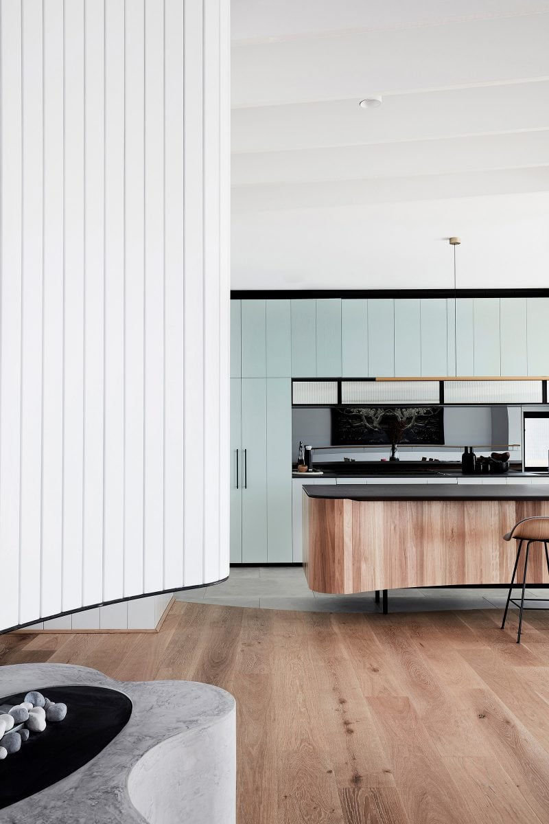 Luigi Rosselli designed kitchen of tamas tee house with reconstituted stone benchtop and blackbutt timber joinery.