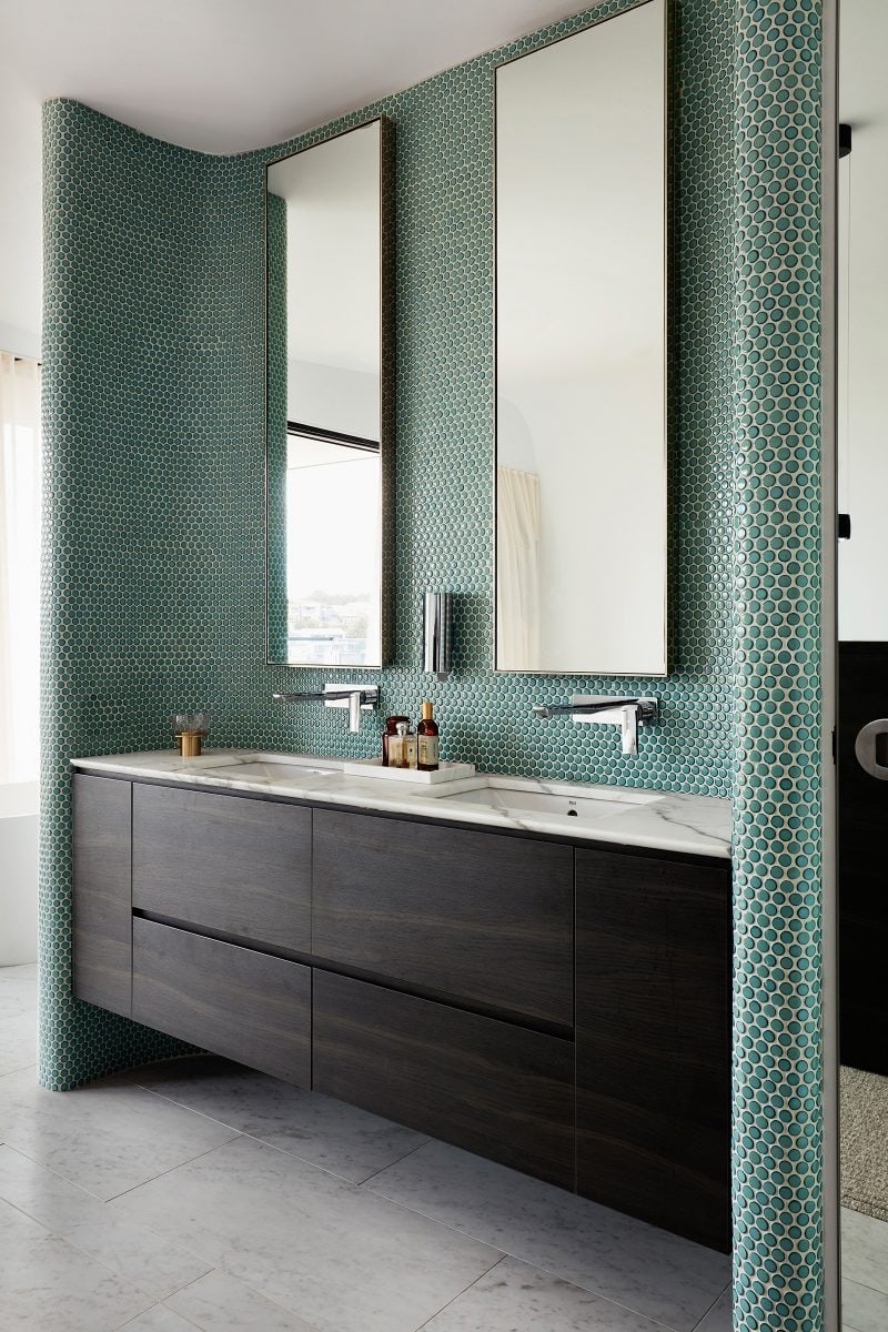 Luigi Rosselli interior, geometric Bathroom tiled mosaic with marbled floor and double basin.